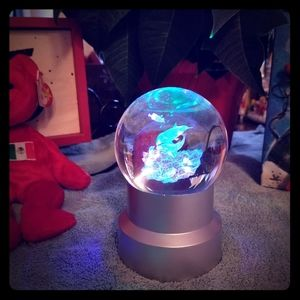 Dolphin laser etched globe with light stand.